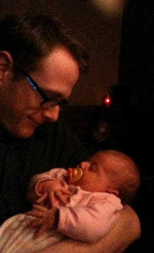 Myself holding my niece, Alice (age: two months). She's also been a healthy distraction this month.