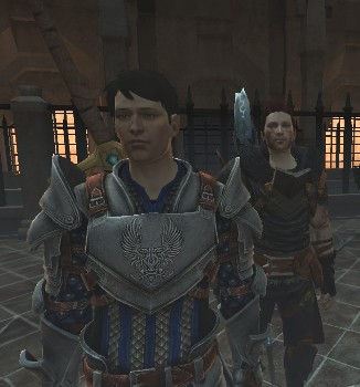 Carver standing in Grey Warden armor, Zel Hawke standing behind, over his left shoulder.