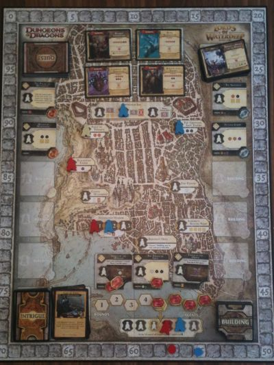The board acts as the city of Waterdeep, clearly outlining which cards and tokens go where.